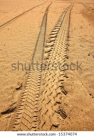 car tracks in the sand