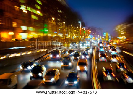 Car traffic at night. Motion blurr?d. Background.