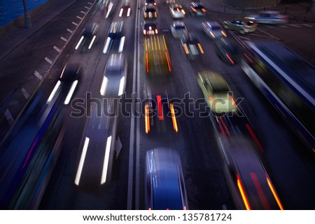 Car traffic at night. Motion blurred background. Long exposure shot.