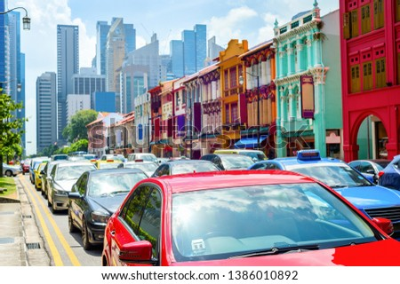 Car traffic, colorful shophouses along street by Neil Road, Singapore modern metropolis skyline #1386010892