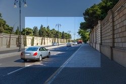 Car traffic in the sight of the camera. Tracking at the crosshairs of the camera