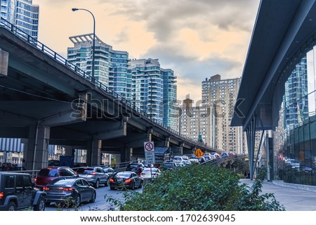 Car traffic jam at the entrance of a freeway in downtown Toronto. City and transport concept. Toronto, Ontario, Canada stock photo