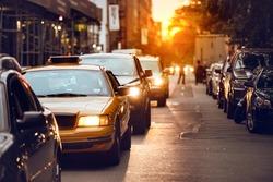 Car traffic on New York City street at sunset time