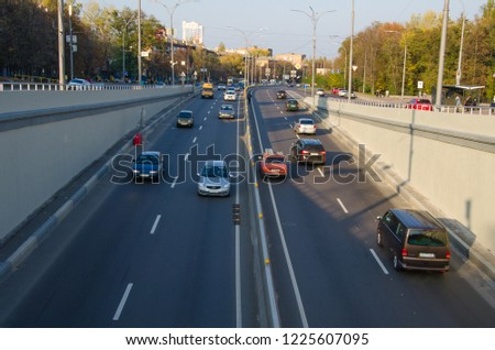 Car traffic on road  in city #1225607095