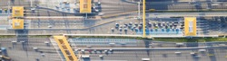 Car traffic transportation on multiple lanes highway road and toll collection gate, drone aerial top view. Commuter transport, city life concept. Banner size