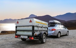 Car trailer and roof rack by the sea