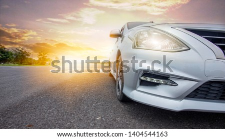 Car traveling in nature on an asphalt road - Front view - Image #1404544163