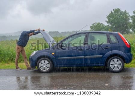 Car trouble in the rain. Broken car. Stock photo ©