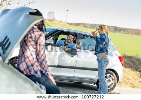 Car troubles two woman friends asking help young man