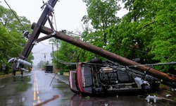 Car turned over after accident with crash electric pole after a severe storm