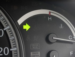 car turning signal lights on car dashboard.