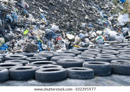 car tyres on garbage polluting nature