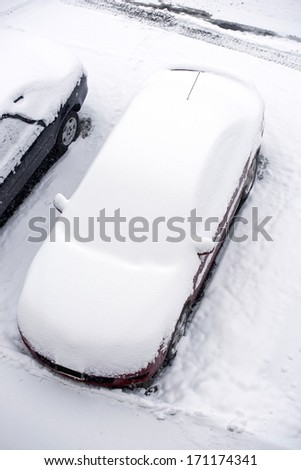 Car Under Snow. Parked Car Covered by Fresh Snow.