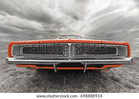 car under the cloudy sky.