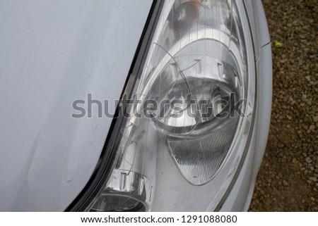 Car / Vehicle Crash. Damage to headlight. #1291088080