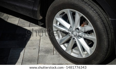 Car vehicle one wheel disk tire dirty dusty close up side view #1481776343