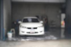 Car Wash Business Banner.Blur focus of  Washing Car.