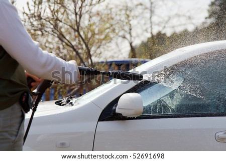 Car washing with sprayed water