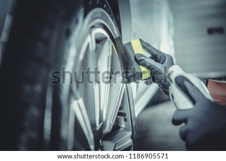Car Wheel and Tires Cleaning and Protecting by Professional Vehicle Detailing Cleaner. #1186905571