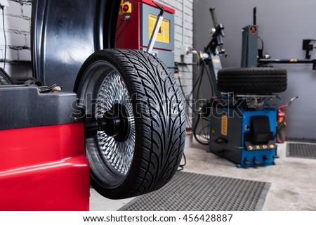 Car wheel balancing in tire service.