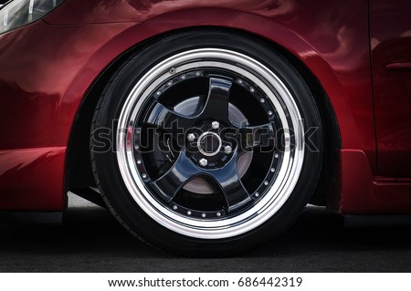 Car wheel on a car close-up. wheel tuning disk #686442319
