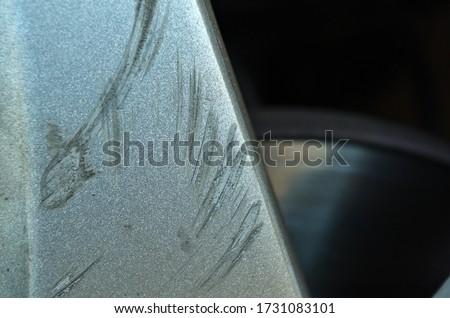 Car wheel scratch damage. Insurance and car rental themes Stock fotó ©