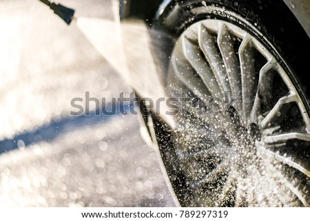 Car wheel washing. Car cleaning with water jet. Car rim wash close up.  #789297319