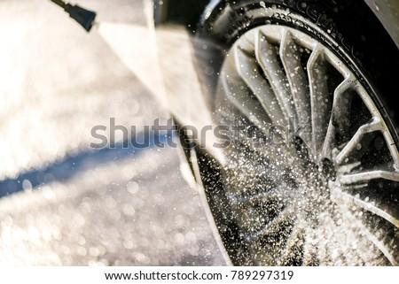 Car wheel washing. Car cleaning with water jet. Car rim wash close up.  #789297319