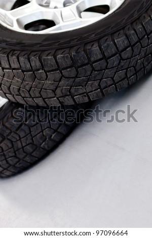 Car wheels or tires lying on the floor