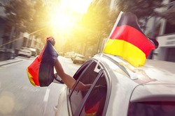 Car with blowing German flags