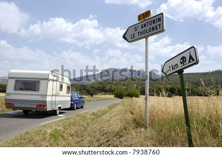 Car with caravan on its way to a French camping