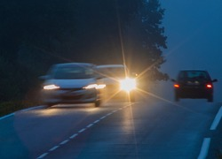 Car with incorrectly adjusted headlights starts to overtake motion blur