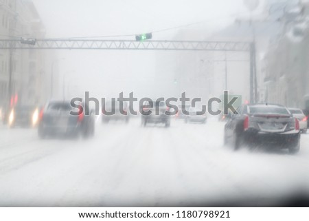 Car with lights on a snow covered road. #1180798921
