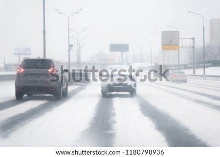 Car with lights on a snow covered road. #1180798936