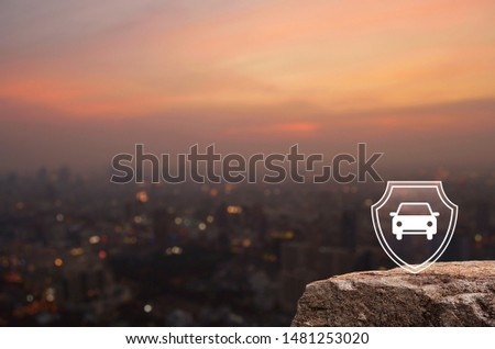 Car with shield flat icon on rock mountain over blur of cityscape on warm light sundown, Business automobile insurance concept #1481253020