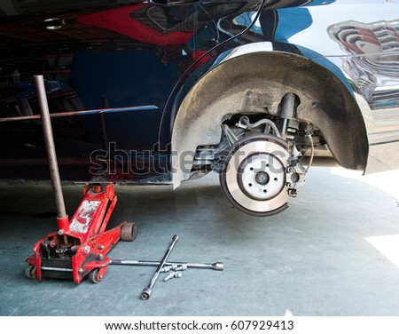 Car without tire need to be repaired. #607929413