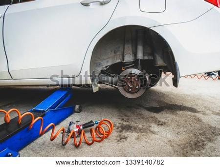 Car without tires, Tire Repair Shop #1339140782