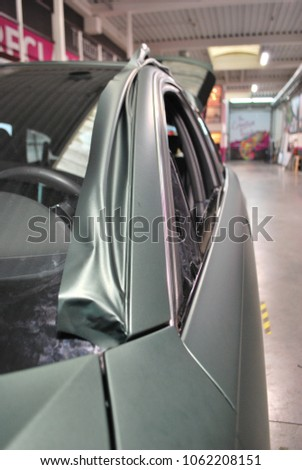 Stock Photo Car wrap in military green foil sticker