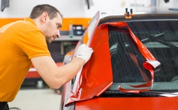 Car wrapping with red adhesive film and Foil cutting