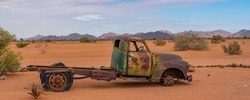 Car wreck in the Namib Naukluft National Park at Betta, Namibia, Africa, panorama