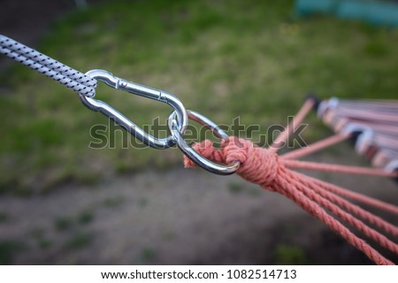 Carabiner holds a rope for a hammock close-up