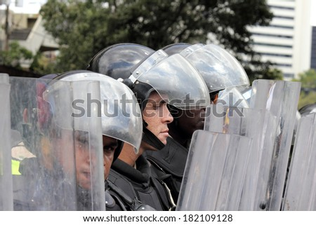 CARACAS, VENEZUELA - MARCH 16, 2014: State police blocking the passage of the protesters who claim for violations of human rights and the killing of civilians in peaceful demonstrations
