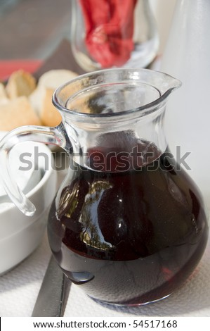 carafe of red house table wine with crusty French bread in Ajaccio Corsica France