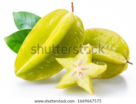 Carambola fruit with slice of star fruit and leaves isolated on a white background. Сток-фото ©