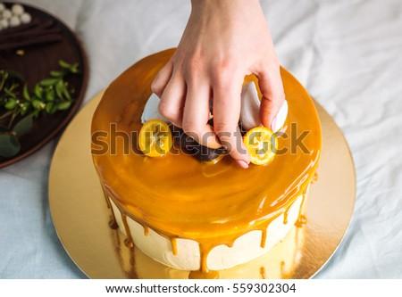 Caramel cake decoration process #559302304