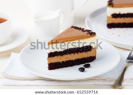 Caramel cake, mousse dessert on a plate. White background.