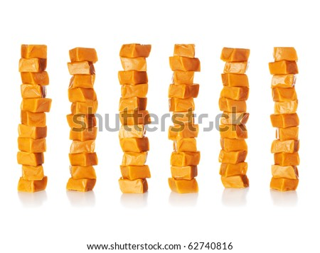 Caramel candy square shape stacks image isolated on a white background