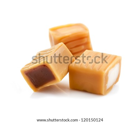 caramel candy with chocolate and cream filling isolated on white background