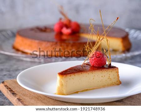 Caramel custard Custard pudding Flan crema volteada dessert - Creme caramel is a custard dessert garnished with a coating of caramel sauce