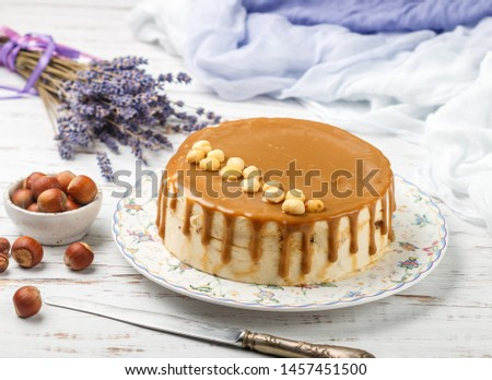 Caramel hazelnut cake. Gourmet mousse dessert for gourmets. Sweet treat for tea or coffee. Selective focus
